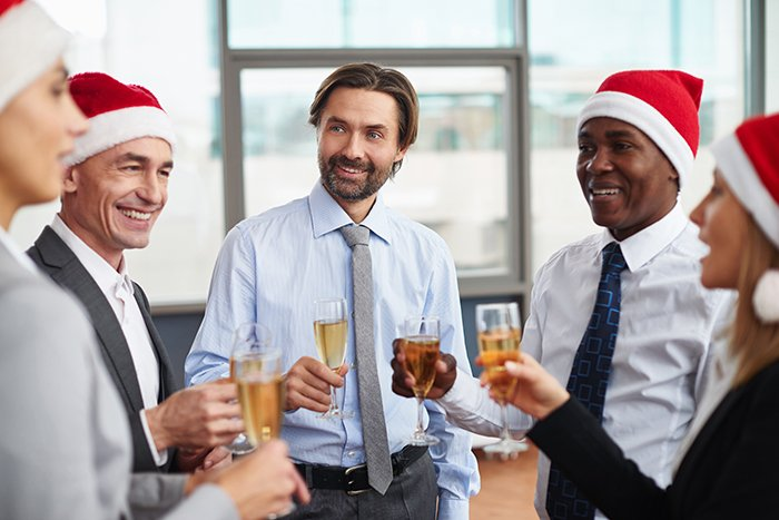 Holiday party with business people in Santa hats
